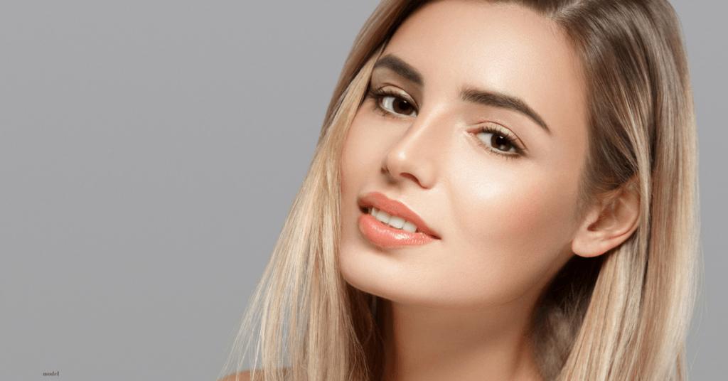Headshot of female model with sandy blonde hair