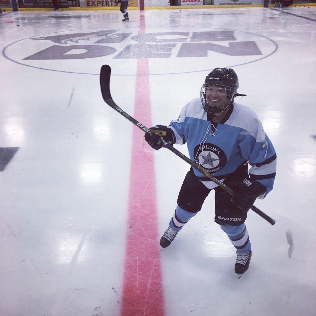 Plastic Surgeon Todd Hobgood playing hockey