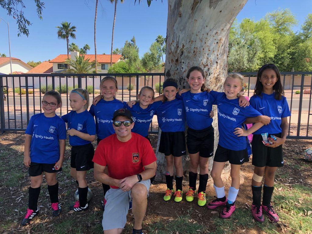 Plastic surgeon Dr. Hobgood coaching soccer