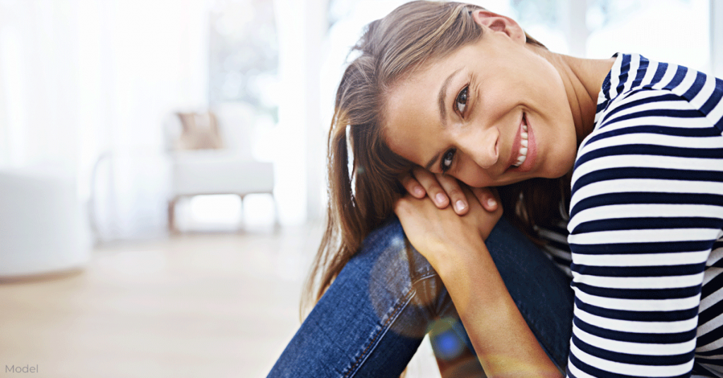 Woman smiles while relaxing indoors